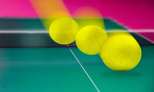"""Three yellow balls from the videogame Pong, in which an """"adversary"""" appeared to pull the ball slightly further down than it actually was."""